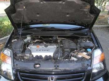 Honda stream | 2,0-литровый K20A под капотом Stream расположен достаточно плотно, однако основное обслуживание (замена масла, фильтра, свечей зажигания, а также проверка уровней жидкостей и долив «незамерзайки» проблем не доставляет