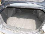 Основной недостаток багажника Epica — сильно выступающие внутрь колесные арки, не только сужающие полезное пространство, но и отнимающие часть объема | Chevrolet Epica LT