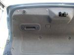 Крышка багажника имеет обивку и выемку для закрывания, но последняя находится чересчур далеко от края | Chevrolet Epica LT