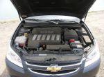 Рядную «шестерку» корейские инженеры умудрились разместить под капотом поперечно! Но компоновка получилась достаточно плотной | Chevrolet Epica LT