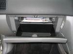 Объем бардачка не рекордный, но бумагу формата А4 принимает без проблем | Subaru Forester 2.5 Turbo STi