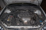 Подкапотное пространство Avancier легко вмещает 3-литровый V6, так что 2,3-литровая рядная «четверка» чувствует себя здесь более чем вольготно | Honda Avancier/Ford Escape