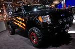 Новый «средний» пикап Ford F-150 FX-4 в авторитетном тюнинге от X-Treme Toyz. Родные бензиновый двигатель Triton 5,4 V8 и 6АКП, выхлопная система AFE, лифт 6 дюймов с амортизаторами Dirt Logic, блокировка заднего дифференциала Mag-Hytec, диски Dick Cepec с бе | SEMA Show