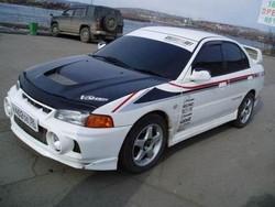 Фестиваль автотюнинга. Четверка с минусом (Mitsubishi Lancer Evolution IV)